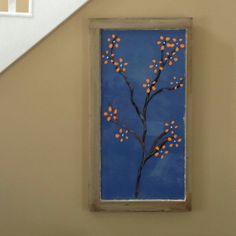 Flowering tree painted on old wood window