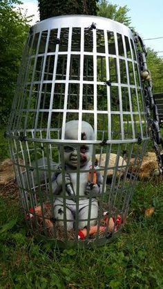 Creepy Halloween Cage made from Dollar Store Laundry Baskets...so cool!