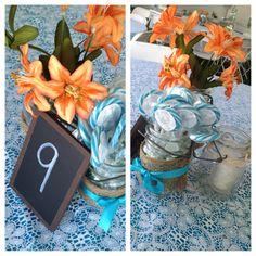 Rustic wedding centerpiece. DIY. Orange and teal