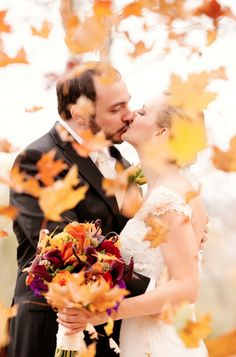 What a lovely shot! Nothing is more romantic than kissing in flying leaves at autumn wedding.