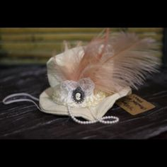 """Steampunk Mini Top Hat - 3 1/2""""H x 6""""L x 6""""D NWT - """"Breakfast at Tiffany's"""" handmade one of a kind, Steampunk Mini Top Hat. Cream color fabric, white lace, peach feathers, white pearls, cameo embellishments. Accessories Hats"""