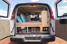 As part of our cargo van conversion, we wanted easy access to the items we store in the back of the van. Learn how we built our own camper van for less than $1000 to live the #vanlife