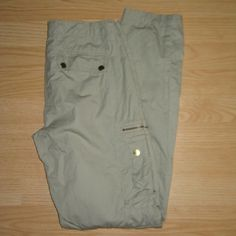 "Michael Kors Lightweight Khaki Cargo Pants These pants are preloved but still in very good condition. They are a khaki/tan lightweight 100% cotton cargo pant. These are not skinny cargos, but I think more of a relaxed straight leg. Tag size is 4. Inseam is approximately 32"" long. MICHAEL Michael Kors Pants Straight Leg"