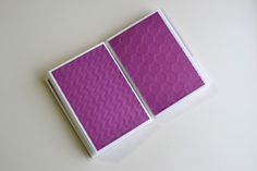 Embossing folder organization using a dollar store photo mini book with samples.