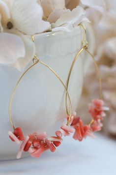 Welcome the warm weather with a pair of pink coral hoop earrings. Perfect for summer time wear at the beach. Pink coral stones are hand wired to the bottom of the hoop. The hoop and the earrings are g