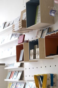 Giant ply peg board wall with removable and interchangeable shelves and boxes.  DOWSE Brighton UK  www.dowsedesign.co.uk