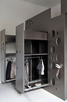 French architect Sandra Courtine of Ciel Architectes has designed a bed unit for a child with circular perforations that form a ladder. The purpose of the unit is to create more usable space and a dedicated children's area in a small room. It incorporates sliding wardrobes and storage space. Circular perforations on a panel of