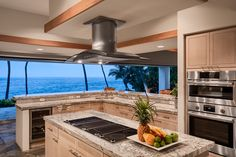 Neutral granite countertops complement sleek, professionally out-fitted appliances to create a kitchen with a view.
