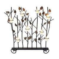 Among ACHLA Designs' many wrought iron screens, this piece adorns the fireplace during the warmer mo