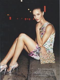 Rosie Huntington-Whiteley. Colourful dress, glittery clutch and silver heels