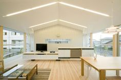 Wonderful Contemporary Home Design: IO Home in Anjo, Aichi: Charming Interior Design At IO House Use White Oak Flooring And Applied Open Floor Decoration Between Living And Dining Room ~ CATALYZE Architecture Inspiration