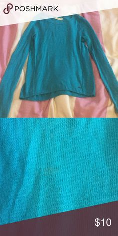Bright blue crew neck sweater Bright blue sweater perfect for fall and winter. Has a small stain on the front (pictured) but barely noticeable. Cute with some boots and a scarf Hollister Sweaters Crew & Scoop Necks
