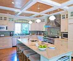 The island with the stools - I need it - I would actually move the stove top to the island if possible