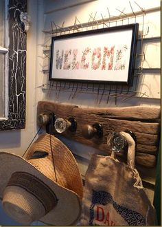 Love the antique door knobs as coat rack idea. Minus the rustic wood, welcome sign and ugly hats.