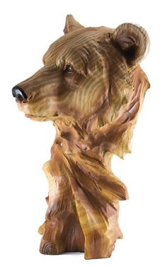 Bear head bust figurine. The painted finish gives a real wood grain appearance and bark texture makes it appear to be carved from a real branch.  Fine detailing in high quality resin. Height:  11.25 inches Width:  6.75 inches Material:  Polyresin