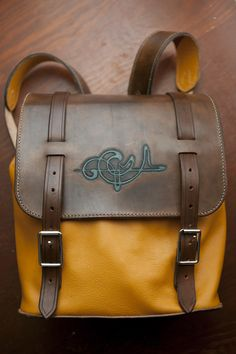 Golden orange backpack, tooled, and hand made. Trim Go Trix