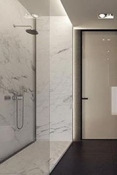 LIGHTING + MARBLE - Indirect lighting and marble shower, bathroom by Tamizo Architects _