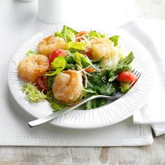 Crispy Shrimp Caesar Salad Recipe -My friend Jane and I have a favorite lunch spot that serves a fantastic salad on Wednesdays. I made my own version at home so I can share it with my family and eat it whenever I want. Save a lot of prep time and buy peeled, deveined shrimp and pre-washed lettuce. —Marla Clark, Albuquerque, New Mexico