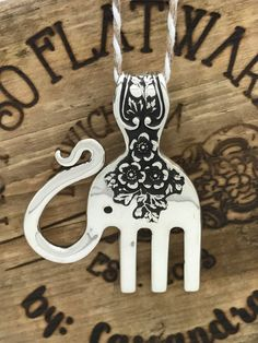 This cutie is a solid sterling silver elephant pendant hand made from sterling fork. The original fork was from The Gorham Co. The pattern is called Buttercup and is from 1899. He is adorable with his curled trunk and floral decorations. He is 1 1/2 wide and about 2 tall. The pendant