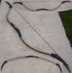 """Hungarian Recurve Bow C, sometimes referred to as a reflex bow (because unlike standard recurves, the limbs curve twice) or a composite bow (because of the multiple materials used). These bows have the same power as an English longbow in a much shorter package, allowing the bow to be used from horseback. Hungarian bows are notable for the """"ears"""" which the string loops around."""