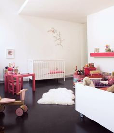 dark floors, white walls and pink accents