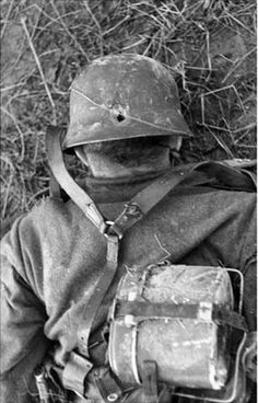 Russia 1943. Helmets were good for pistol shots, but rifle bullets were a whole other deal.
