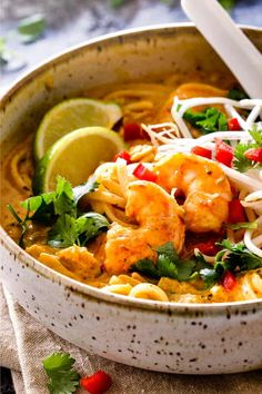 up close side view of Singapore laksa recipe with shrimp, cilantro and lime Laksa Soup Recipes, Chicken Soup Recipes, Shrimp Recipes, Singapore Laksa Recipe, Singapore Food, Asian Recipes, Healthy Recipes, Ethnic Recipes, Asian Foods