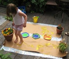 Outdoor open-ended, messy art. Provide several unusual painting tools for experimentation...but be prepared for bare feet experimentation! (Wear old clothes!)