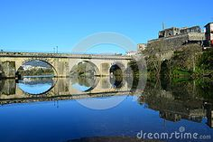 Historical center of Barcelos city, Portugal, with medieval bridge and the Palace ruins reflected on the river.