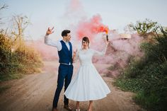 When your bride and groom bring a smoke flare with them for evening couple photos - epic! Photo by Benjamin Stuart Photography #weddingphotography #brideandgroom #coupleshot #smokeflare #rockon #justmarried #goldenhour