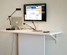 A standing desk that takes up minimal space. Good for the computer, not so much for impromptu crafting.