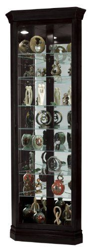 The Duane Corner Curio by Howard Miller is finished in Black Satin on select hardwoods and veneers and features a beveled glass door. Adjustable glass shelves with continuous holes for maximum shelf adjustment. (Wall Dimension: 20-inch).   	 		 			 				 					Famous Words of... more details available at https://furniture.bestselleroutlets.com/accent-furniture/display-curio-cabinets/product-review-for-howard-miller-680-487-duane-curio-cabinet-by/