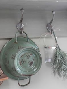hang a small white shelf with two or three hooks under shelf...red colander on one hook, other accessories on remaining hooks...cookbooks on shelf?