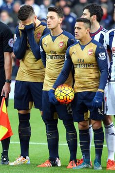 Olivier Giroud, Mesut Özil, and Alexis Sanchez as the French National Anthem was played before the match.