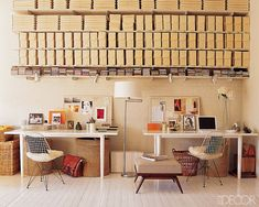Office Envy: Shelving holds boxes filled with art and film supplies, the Eames chairs are vintage.
