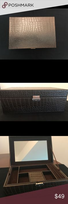 Chocolate, Croc-Embossed elegant jewelry box Appropriate for men & women this stately jewelry case has a mirrored interior and two layers. Chocolate brown soft velvet lines interior. Top layer removes to reveal three spacious divided sections perfect for watches or larger pieces. Jewelry