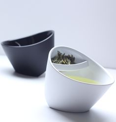 Tea cups with built-in tea filters on top. Perfect for non-conventional tea leaves that don't come in handy pouches.