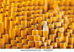 One sharpened pencil among many blunt ones. - stock photo