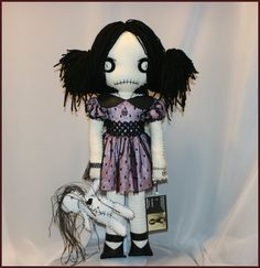 https://www.etsy.com/listing/210370264/ooak-hand-stitched-rag-doll-with-voodoo?ref=shop_home_active_1
