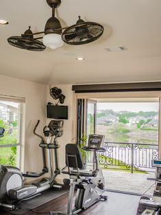 Exercise Rooms Design - Like fans on light fixture... love these doors, it would be cool to have these looking out on the lake!