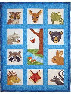 """Ten sweet animal faces surround a wooded setting in this lovely quilt. Each animal requires 3--5 scrap fabrics. You can draw in the features, embellish with buttons, ribbon, beads and more! Finished size is 31"""" x 40""""."""