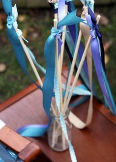 Ribbon wand - I made these with 8-inch cake pop sticks. I covered the sticks with ribbon then attached 3 different long strands of ribbon for my girls 3rd bday party. They are very cute and fun.....so easy!