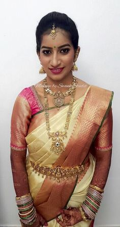 Traditional South Indian bride Harshita looks beautiful for her muhurtam in bridal silk saree and jewellery. Makeup and hairstyle by Swank Studio. Bridal jewelry. Bridal hair. Silk sari. Bridal Saree Blouse Design. Indian Bridal Makeup. Indian Bride. Gold Jewellery. Statement Blouse. Tamil bride. Telugu bride. Kannada bride. Hindu bride. Malayalee bride. Find us at https://www.facebook.com/SwankStudioBangalore