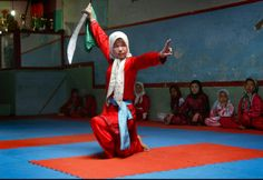 An Afghan girl practices the martial arts with a sword at a Wushu training club in Injil, Herat province, west of Kabul, April 6. Who said Muslim women were restricted?? Badass.