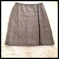 Brooks Brothers woman's skirt Classic Glenn plaid skirt from Brooks Brothers with front side slit.  Straight cut with back center zipper. Waist measures 31 inches. Looks great with black tights and any color blouse or sweater. Great for the office. 92% wool and 8% cashmere. Fully lined. Brooks Brothers Skirts Midi