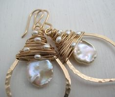 """Gold Keshi Pearl Leaf Hoop Earrings by SarahHickeyJewellery, 115$, * beautiful organic cornflake keshi pearl is encircled by a hand forged leaf hoop and topped with fresh water pearls.  The hoop is hand formed, lightly hammered and highly polished to let the light catch each facet. Chic and organic, these earrings are so feminine and are a truly versatile accessory, complimenting every look! Hangs1.4"""" from Ear (3.75cm)"""