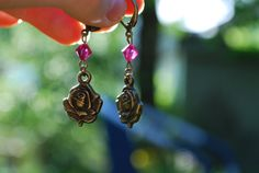 Earrings with little rose charms and beautiful swarovski crystal. With clasps instead of hooks. Quite discrete, yet noticeable accessory :).