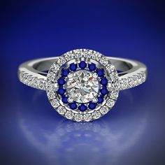 Deluxe Halo Ring || Round Cut Diamond Halo Ring With Blue Sapphire In 14K White Gold