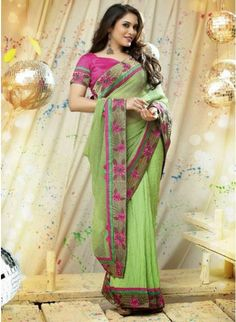 Impressive Green color Printed #Saree With Zari Work #designersarees #clothing #womenswear #womenapparel #ethnicwear