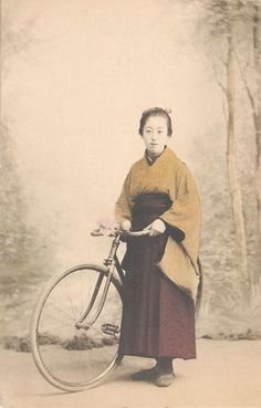 Japanese female student with bicycle, ca. 1900s